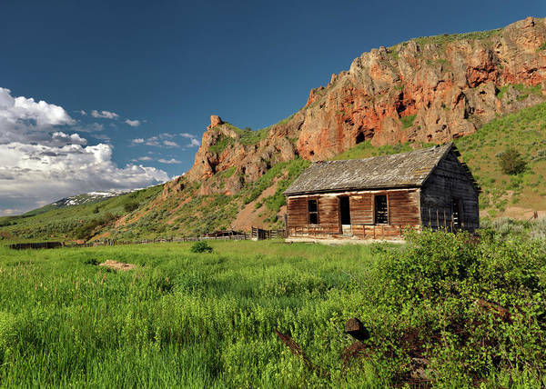 Antiquated Poster featuring the photograph Red Rock Cabin by Leland D Howard