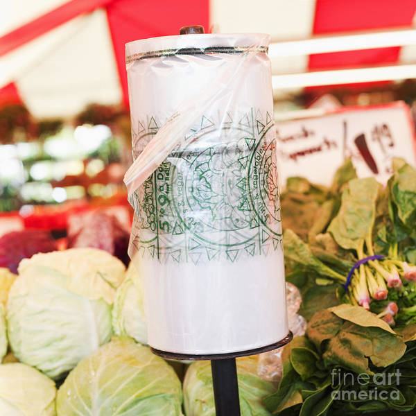 Bag Poster featuring the photograph Roll Of Plastic Produce Bags In A Market by Jetta Productions, Inc
