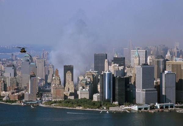 2000s Poster featuring the photograph Smoke From The Ruins Of The World Trade by Everett
