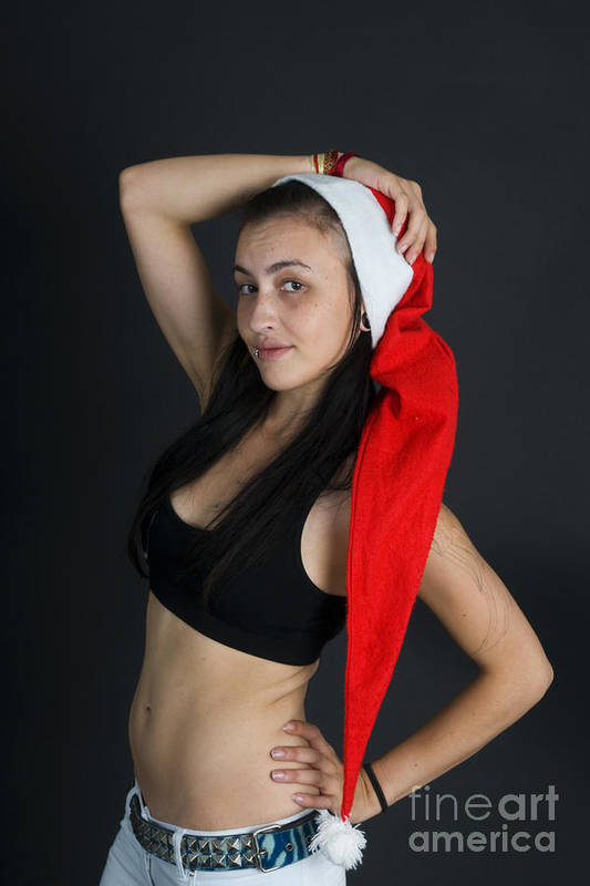 Christmas Card Poster featuring the photograph Young Woman Wearing Santa Hat by Ilan Rosen