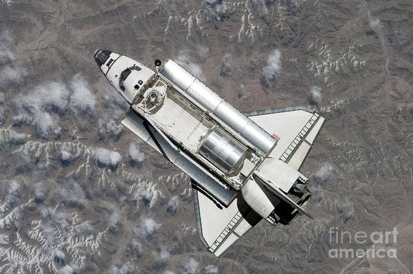 Directly Above Poster featuring the photograph Aerial View Of Space Shuttle Discovery by Stocktrek Images
