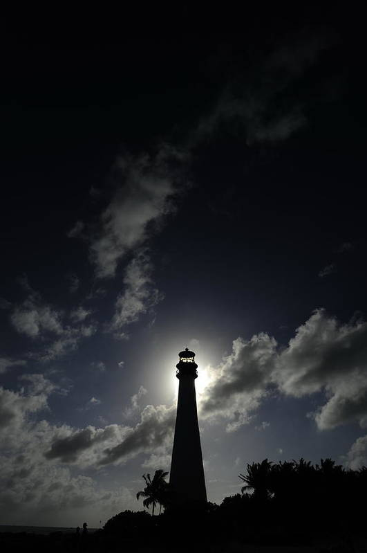 Outdoors Poster featuring the photograph A Backlit View Of A Lighthouse Built by Raul Touzon