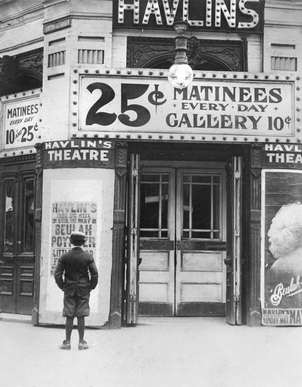 1910s Poster featuring the photograph Boy In Front Of A Movie Theater Showing by Everett