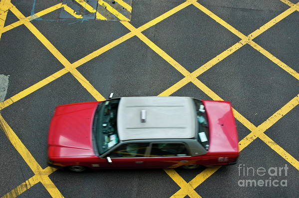 Asia Poster featuring the photograph Red Taxi Cab Driving Over Yellow Lines In Hong Kong by Sami Sarkis