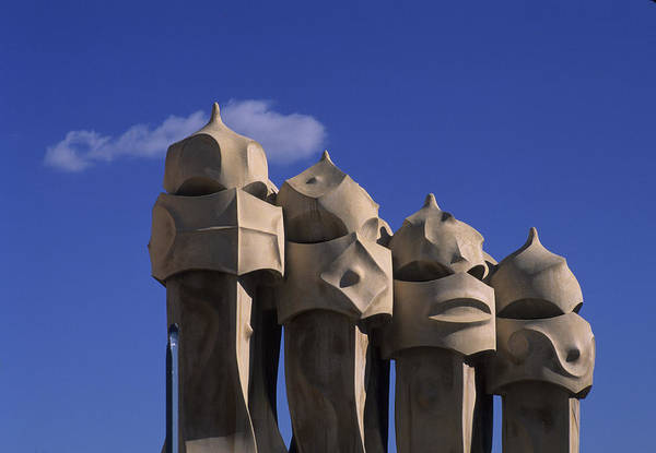 Antoni Gaudi Poster featuring the photograph The Strangely Shaped Rooftop Chimneys by Taylor S. Kennedy