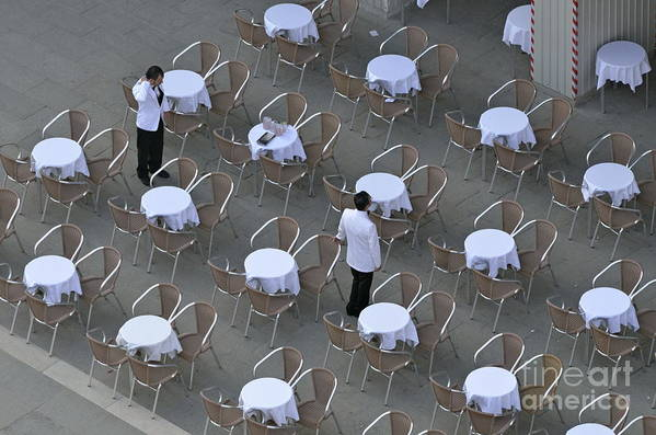 Venice Poster featuring the photograph Waiters At Empty Cafe Terrace On Piazza San Marco by Sami Sarkis