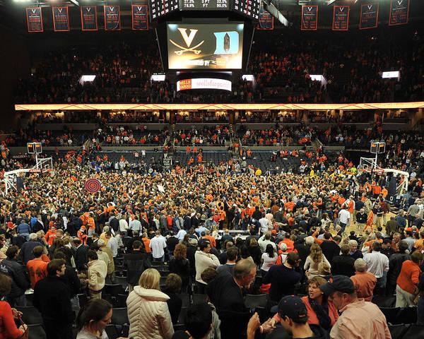 Virginia Cavaliers Print featuring the photograph Virginia Fans Storm Court At John Paul Jones Arena by Replay Photos
