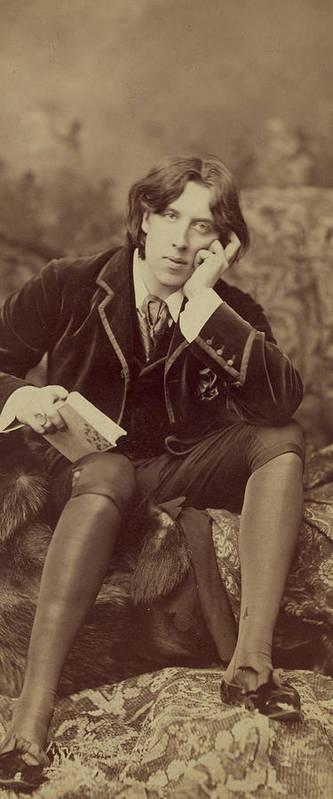 Oscar; Wilde; Irish; Writer; Poet; Author; Dandy; Photograph; Sepia; Black; White; Velvet; Smoking; Jacket; Breeches; Wearing; Stockings; Full; Length; Seated; Oscar Wilde Print featuring the photograph Oscar Wilde 1882 by Napoleon Sarony