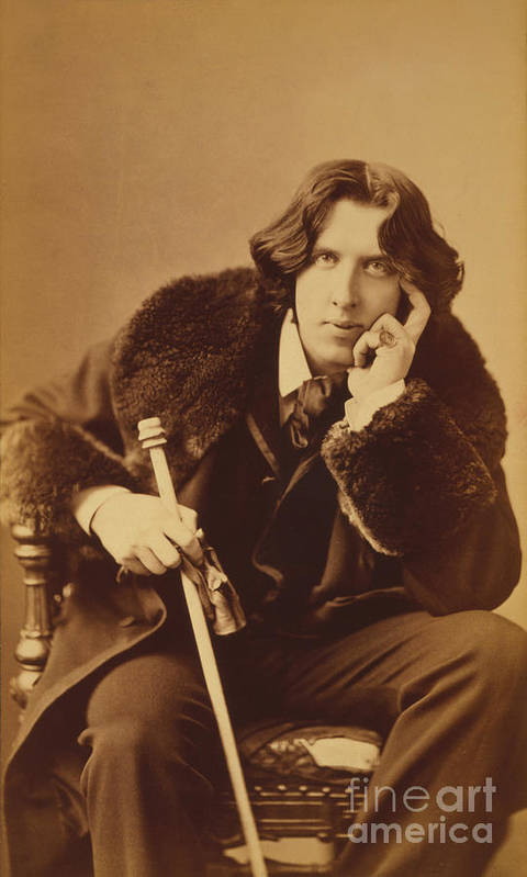 Oscar; Wilde; Irish; Writer; Poet; Author; Dandy; Cane; Fur; Trimmed; Coat; Victorian; Portrait; Three; Quarter; Length; Photograph; Sepia; Black; White Print featuring the photograph Oscar Wilde 1882 by Napoleon Sarony