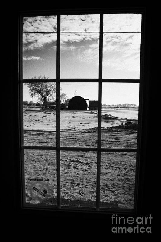Looking Print featuring the photograph looking out through door window to snow covered scene in small rural village of Forget by Joe Fox