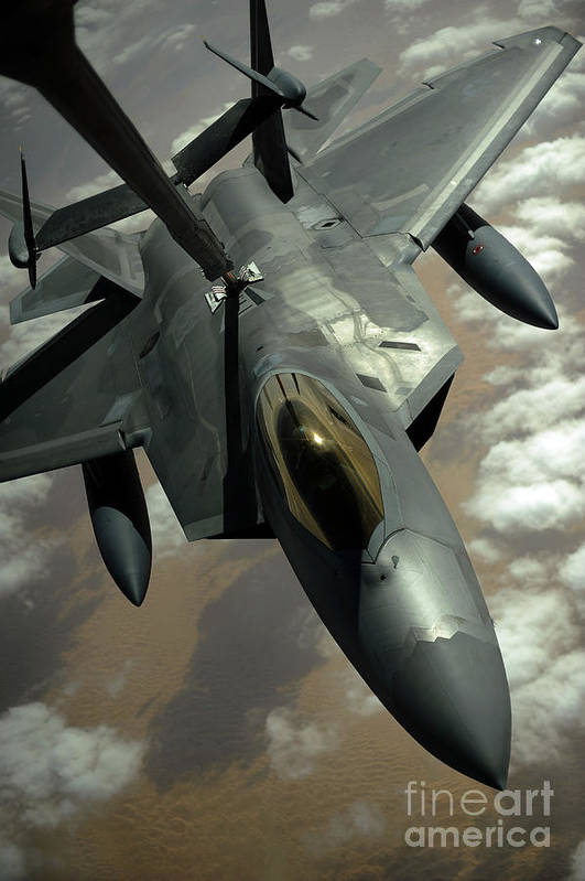 Warplane Print featuring the photograph A U.s. Air Force F-22 Raptor by Stocktrek Images