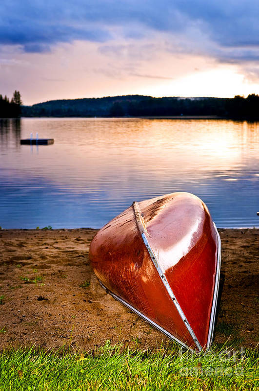 Canoe Print featuring the photograph Lake Sunset With Canoe On Beach by Elena Elisseeva