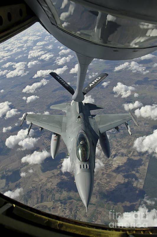 Transportation Print featuring the photograph A Chilean Air Force F-16 Refuels by Giovanni Colla
