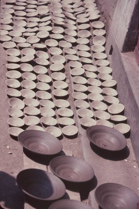 Hand-thrown Pottery Print featuring the photograph Clay Yogurt Cups Drying In The Sun by David Sherman