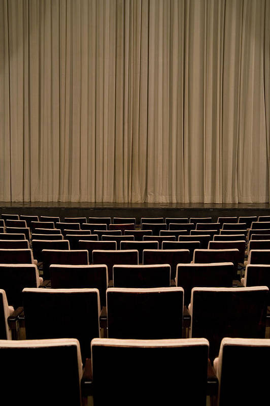 Vertical Print featuring the photograph Closed Curtain In An Empty Theater by Adam Burn