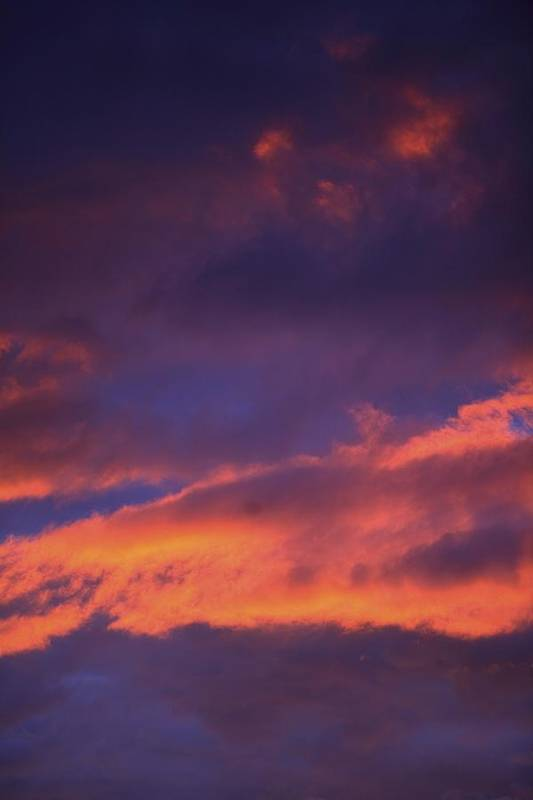 Atmospheric Print featuring the photograph Clouds In Sky With Pink Glow by Richard Wear