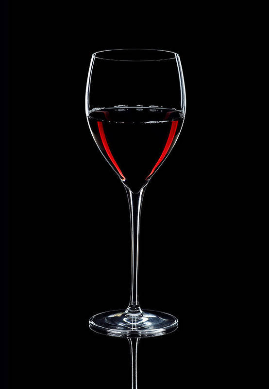 Wine Print featuring the photograph Wineglass Filled With Red Wine Silhouette by Alex Sukonkin
