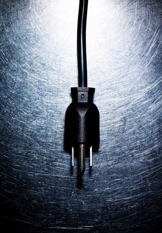 Vertical Print featuring the photograph Three-pronged Electrical Plug On Stainless Steel. by Ballyscanlon
