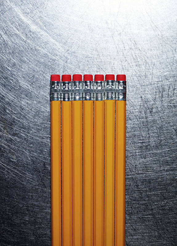 Vertical Print featuring the photograph Yellow Pencils With Erasers On Stainless Steel. by Ballyscanlon