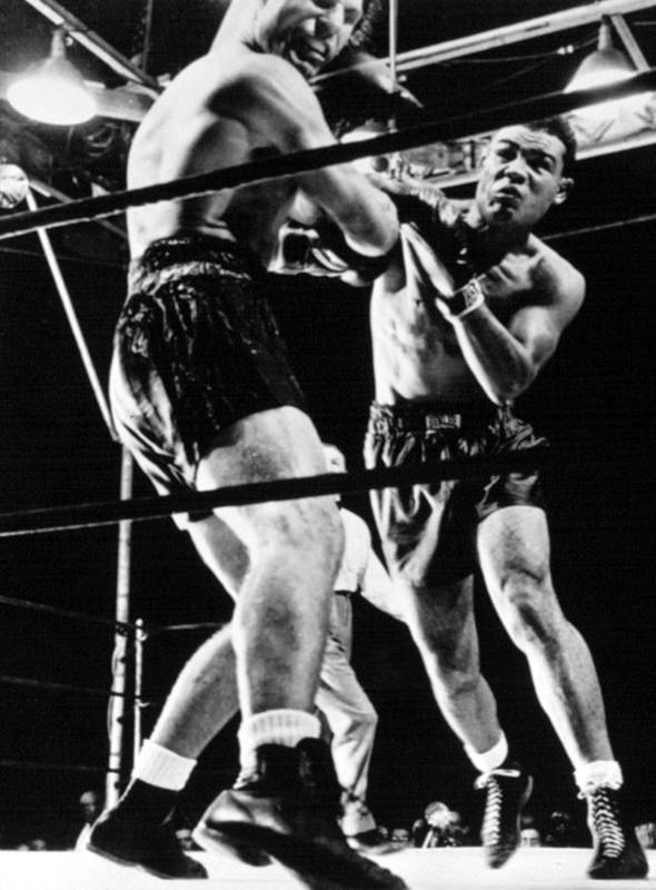 Boxing Print featuring the photograph Joe Louis Delivers Knockout Punch by Everett