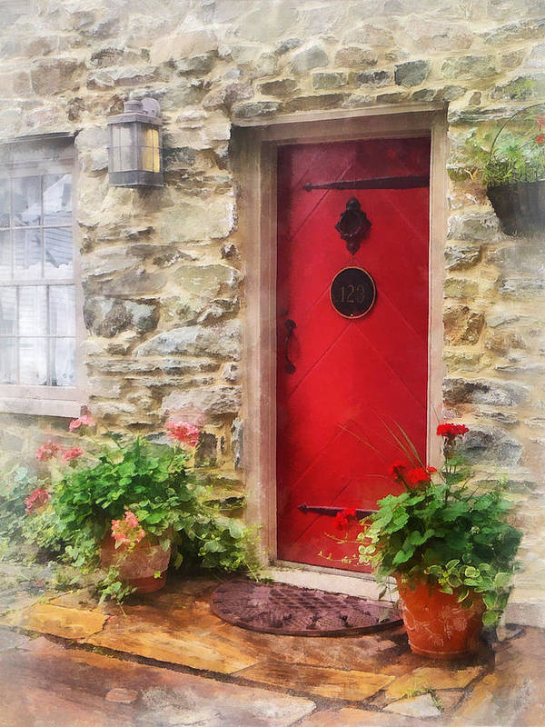 Door Print featuring the photograph Geraniums By Red Door by Susan Savad