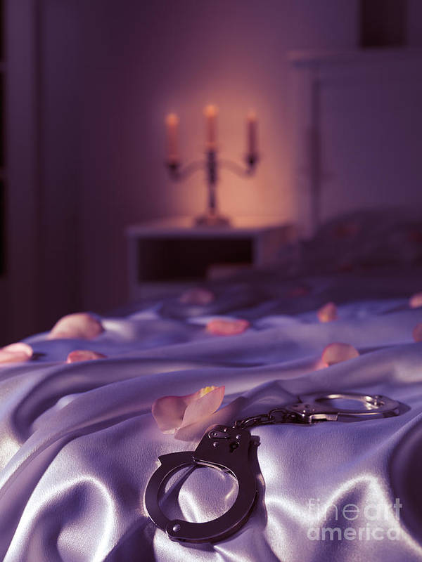 Bondage Print featuring the photograph Handcuffs And Rose Petals On Bed by Oleksiy Maksymenko