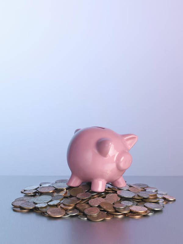 Vertical Print featuring the photograph Piggy Bank On Pile Of Coins by Arb