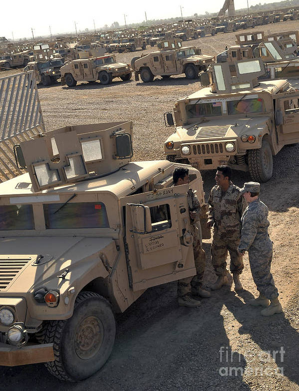 M1114 Print featuring the photograph U.s. Army Soldier Speaks With Iraqi by Stocktrek Images