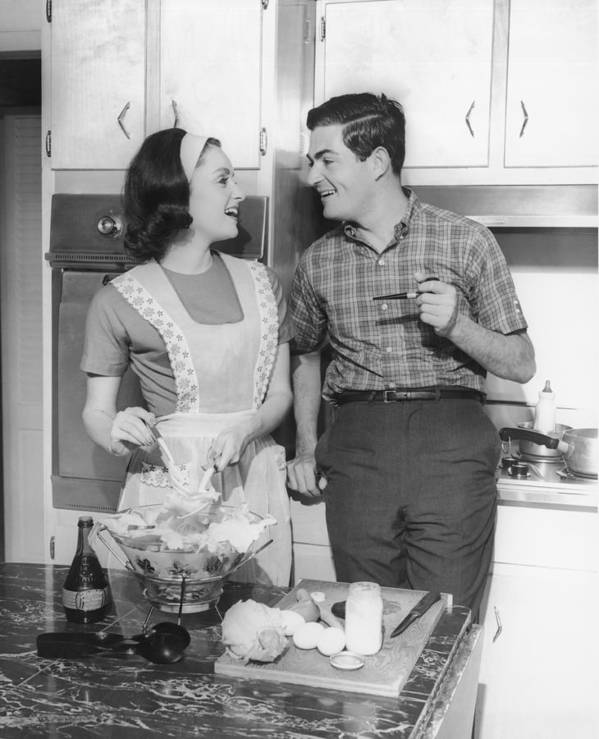 30-34 Years Print featuring the photograph Couple Standing In Kitchen, Smiling, (b&w) by George Marks