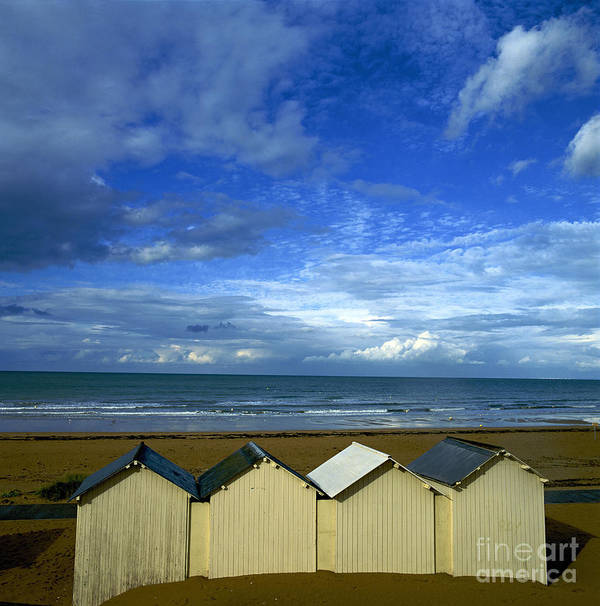 Wooden Print featuring the photograph Beach Huts Under A Stormy Sky In Normandy by Bernard Jaubert
