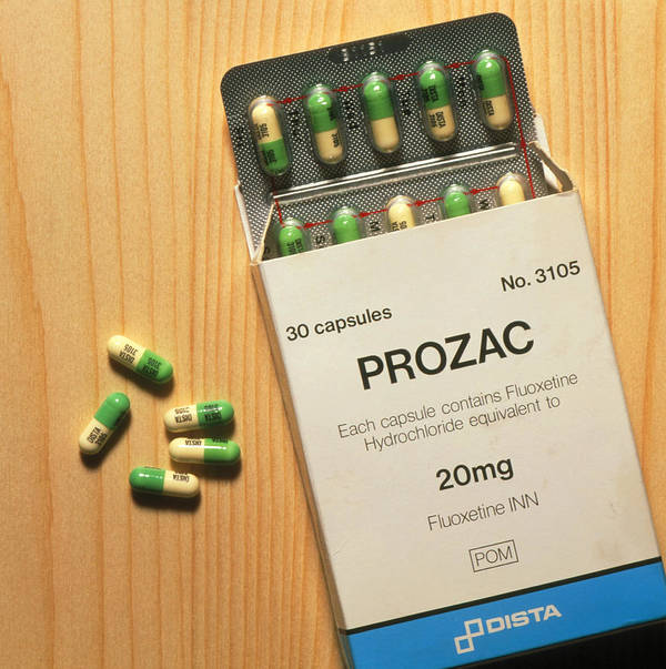 Prozac Drug Print featuring the photograph Prozac Pack With Pills On Wooden Surface by Damien Lovegrove