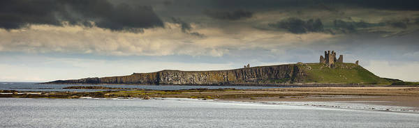 Cloud Print featuring the photograph Dunstanburgh Castle On A Hill Under A by John Short