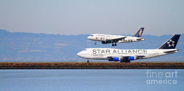 Long Print featuring the photograph Star Alliance Airlines And Frontier Airlines Jet Airplanes At San Francisco Airport . Long Cut by Wingsdomain Art and Photography