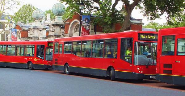 Buses Print featuring the photograph A Bevy Of Buses by Anna Villarreal Garbis