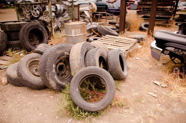 Tires Print featuring the photograph Iron Boneyard 1 by Matthew Angelo