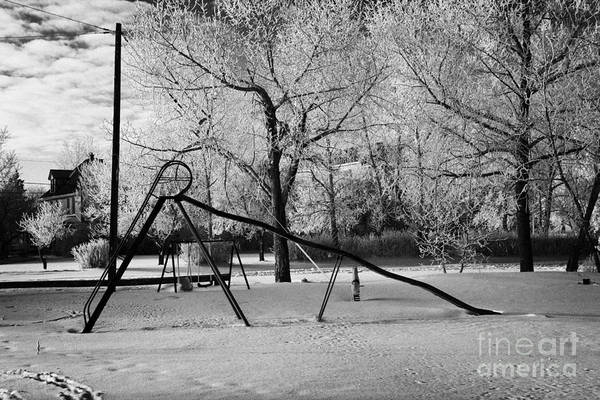 Hoar Print featuring the photograph empty childrens playground with hoar frost covered trees on street in small rural village of Forget by Joe Fox