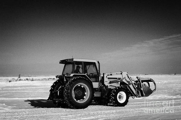 International Print featuring the photograph international 5140 tractor with front end loader on frozen field Forget Saskatchewan Canada by Joe Fox