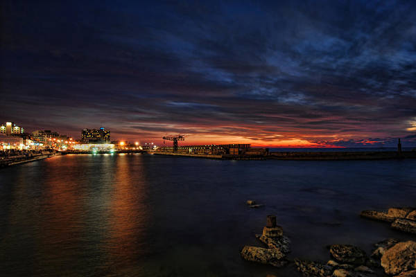 Israel Print featuring the photograph a flaming sunset at Tel Aviv port by Ron Shoshani