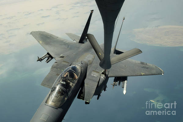 Afghanistan Print featuring the photograph An F-15e Strike Eagle Receives Fuel by Stocktrek Images