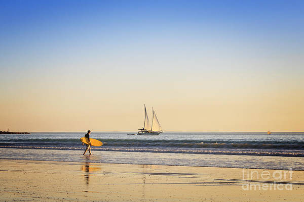 Ambience Print featuring the photograph Australia Broome Cable Beach Surfer And Sailing Ship by Colin and Linda McKie