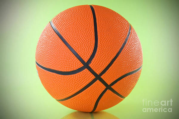Basketball Print featuring the photograph Basketball Ball Over A Green Background by G J