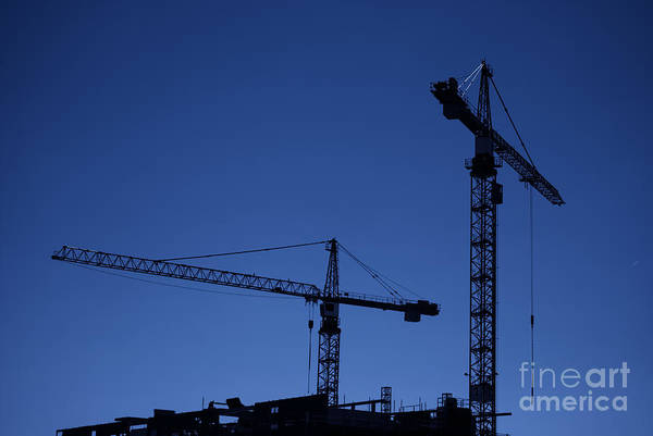 Construction Print featuring the photograph Construction Cranes At Dusk by Antony McAulay