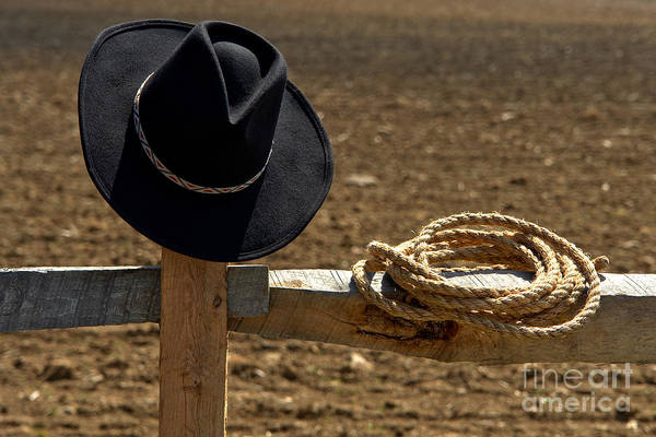 Western Print featuring the photograph Cowboy Hat And Rope On Fence by Olivier Le Queinec