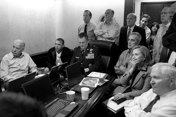 Bin Laden Raid Print featuring the photograph Obama In White House Situation Room by War Is Hell Store