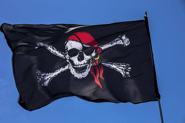 Pirate Flag Skull Banner Piracy Scull Robbers Terror Terrorist F Print featuring the photograph Pirate Skull Flag With Red Scarf by Garry Gay