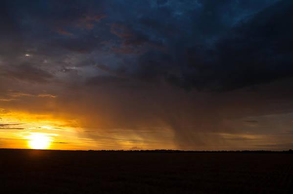 Rain Print featuring the photograph Rainy Sunset by Brandon Ivey