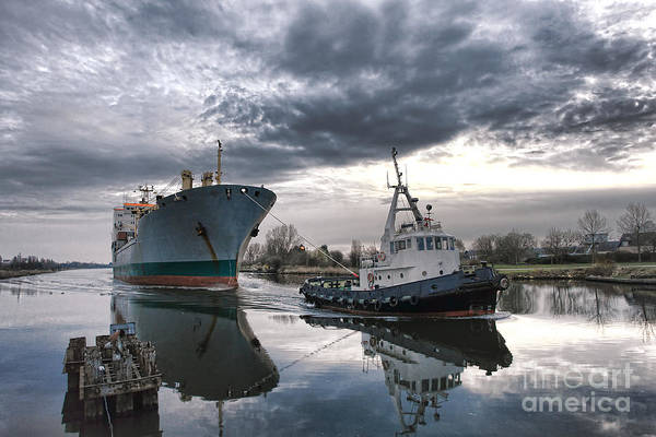 Tugboat Print featuring the photograph Tugboat Pulling A Cargo Ship by Olivier Le Queinec
