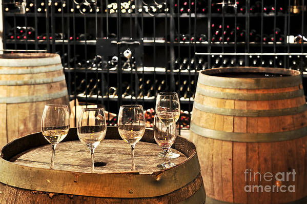 Wine Print featuring the photograph Wine Glasses And Barrels by Elena Elisseeva