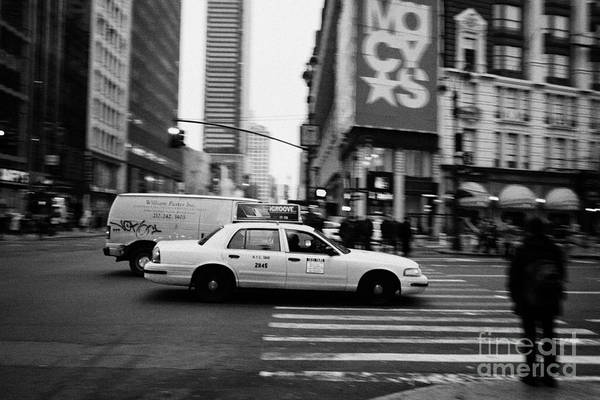 Usa Print featuring the photograph yellow cab taxi blurs past pedestrian waiting at crosswalk on Broadway outside macys new york usa by Joe Fox