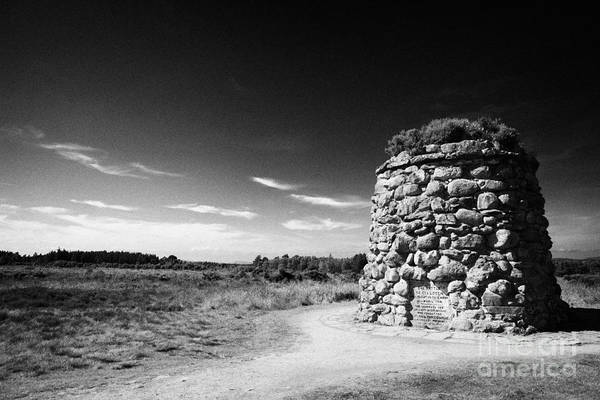 The Print featuring the photograph the memorial cairn on Culloden moor battlefield site highlands scotland by Joe Fox